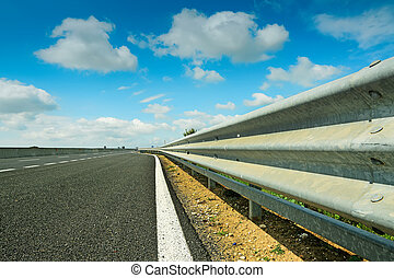 guard rail and clouds