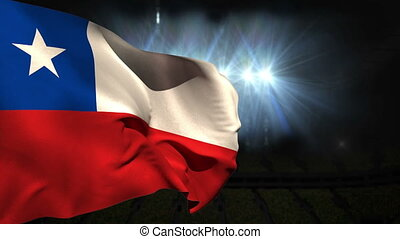 Large chile national flag waving on black background with...