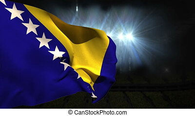 Large bosnia national flag waving on black background with...