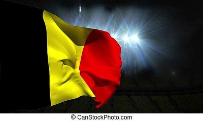 Large belgium national flag waving on black background with...