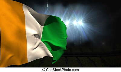 Large ivory coast national flag waving on black background...