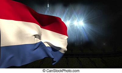 Large netherlands national flag waving on black background...