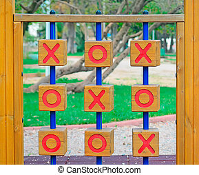 noughts and crosses in the park - wooden tic tac toe in a...