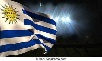 Large uruguay national flag waving on black background with...