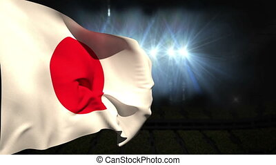Large japan national flag waving on black background with...