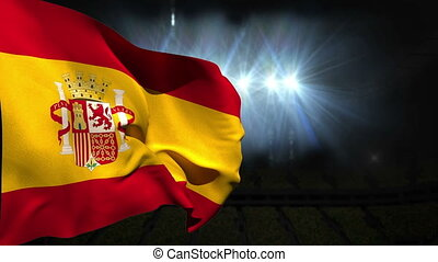 Large spain national flag waving on black background with...