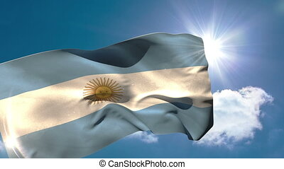 Argentina national flag blowing in the breeze on blue sky...