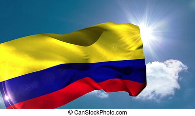 Colombia national flag blowing in the breeze on blue sky...