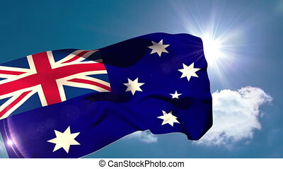 Australia national flag blowing in the breeze on blue sky...
