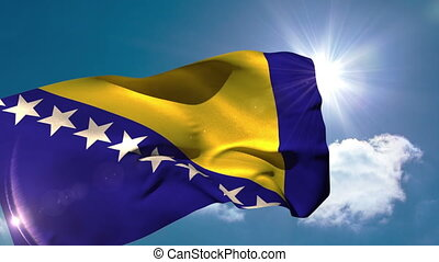 Bosnia national flag blowing in the breeze on blue sky...