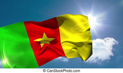 Cameroon national flag blowing in the breeze on blue sky...
