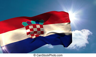 Croatia national flag blowing in the breeze on blue sky...