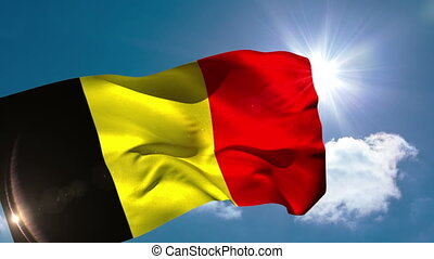 Belgium national flag blowing in the breeze on blue sky...