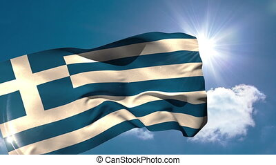Greek national flag blowing in the breeze on blue sky...