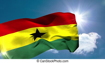 Ghana national flag blowing in the breeze on blue sky...