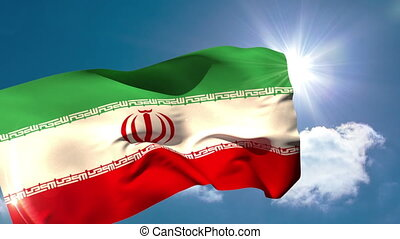 Iran national flag blowing in the breeze on blue sky...