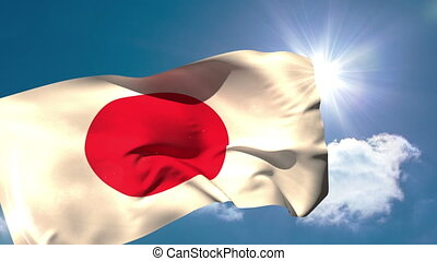 Japan national flag blowing in the breeze on blue sky...
