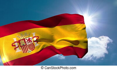 Spain national flag blowing in the breeze on blue sky...