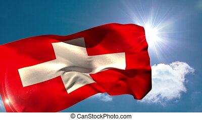 Swiss national flag blowing in the breeze on blue sky...