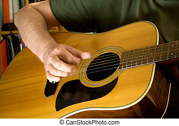 Strumming Guitar - Strumming an acoustic guitar