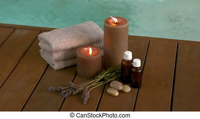 Beauty treatments and candles poolside in slow motion