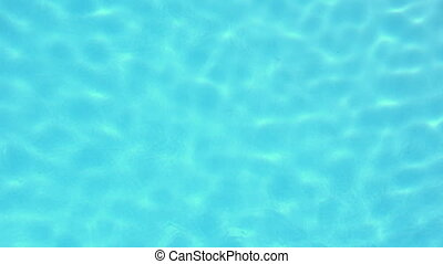Light glimmering on blue swimming pool in slow motion