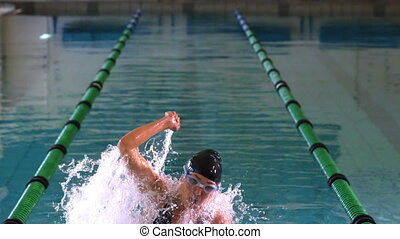 Fit swimmer jumping and cheering in swimming pool in slow...