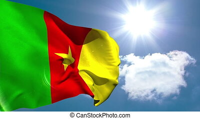 Cameroon national flag waving on blue sky background with...