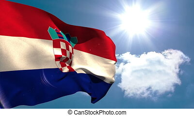 Croatia national flag waving on blue sky background with sun...