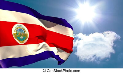 Costa rica national flag waving on blue sky background with...