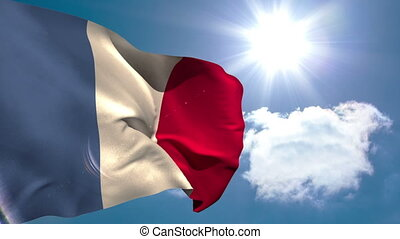 France national flag waving on blue sky background with sun...