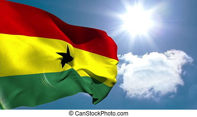 Ghana national flag waving on blue sky background with sun...