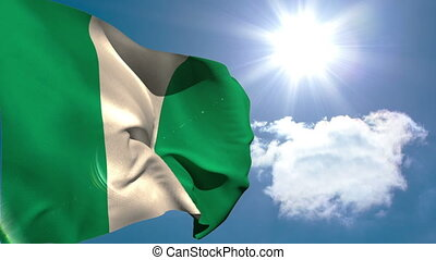 Nigeria national flag waving on blue sky background with sun...