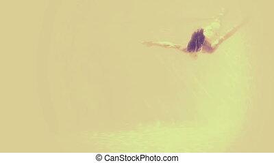Woman in bikini diving into pool and waving in yellow and...