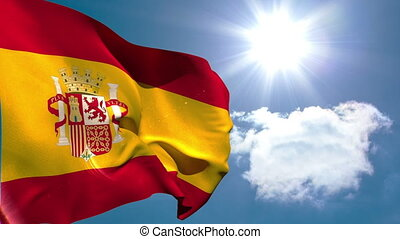 Spain national flag waving on blue sky background with sun...