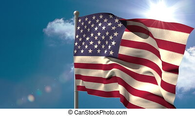 American national flag waving on flagpole on blue sky...