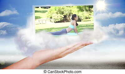 Hand presenting outdoor yoga clips on blue sky background