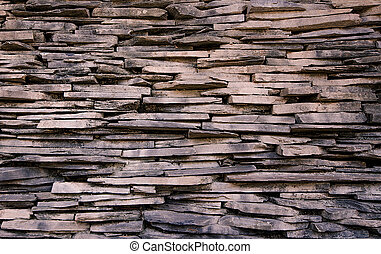 Slate stone wall seamless background texture