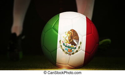 Football player kicking mexico flag ball on black background...