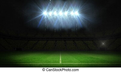 Lights flashing over football pitch - Digital animation of...