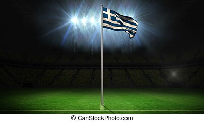 Greece national flag waving on flagpole on football pitch...