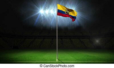 Ecuador national flag waving on flagpole on football pitch...