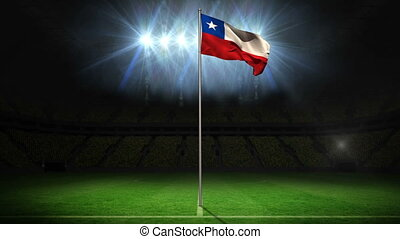 Chile national flag waving on flagpole on football pitch...