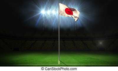 Japan national flag waving on flagpole on football pitch...