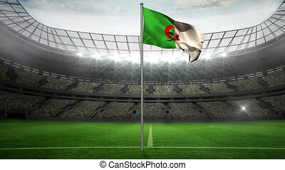 Algeria national flag waving on flagpole in football stadium...