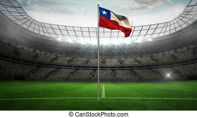 Chile national flag waving on flagpole in football stadium...