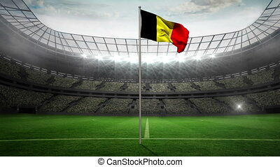 Belgium national flag waving on flagpole in football stadium...