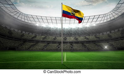 Ecuador national flag waving on flagpole in football stadium...