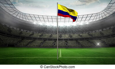 Colombia national flag waving on flagpole in football...