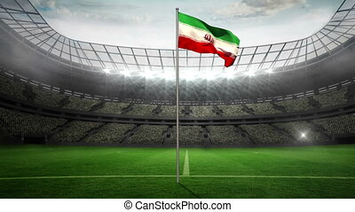 Iran national flag waving on flagpole in football stadium...
